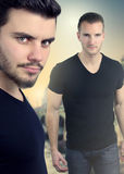 Book cover with two handsome men. Wearing a black shirt Stock Photo