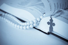 Book and cross. Holy Book and cross,rosary Royalty Free Stock Photography
