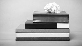 Book and crumpled paper black and white color tone style Royalty Free Stock Photo
