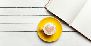 Book and cup of coffee Stock Image