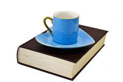 Book, cup and saucer Stock Image