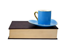 Book, cup and saucer Stock Photos