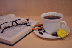 Still life with Book. Cup, tea, coffee, been, glass, rest, reading, flower Stock Photography
