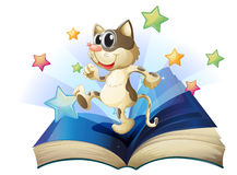 A book with a dancing cat. Illustration of a book with a dancing cat on a white background Stock Photography