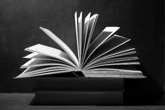 Book on a dark monochrome background Royalty Free Stock Photo
