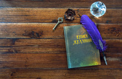 Book of desires, feather and crystal on wooden background Stock Photos