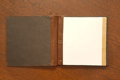 Book on a desk. Note book with empty page stock images