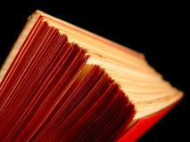 Book detail. Book pages closeup on black background Stock Photography