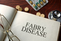 Book with diagnosis Fabry disease and pills. Stock Photo