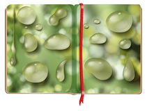 Book with different shapes of waterdrops Royalty Free Stock Photo