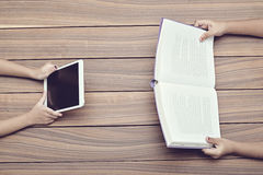 Book and a digital tablet Royalty Free Stock Images