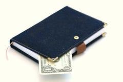 Book and dollar Royalty Free Stock Photos