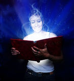 Book of dreams. A girl holding a book of dreams stock images