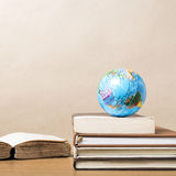 Book and earth ball Royalty Free Stock Photo