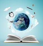 Book and earth Stock Image
