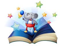 A book with an elephant holding two balloons Stock Photography