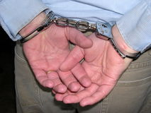 Book 'em Danno. Criminal in handcuffs stock photos