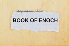 Book of enoch concept. Newspaper cutout in an old paper background Stock Photography