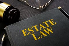 Book estate law and gavel on the table royalty free stock image