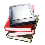 Book Evolution Concept. Stack with fictitious Ebook Reader Royalty Free Stock Photos