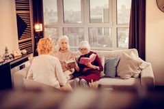 Nice pleasant aged women exchanging their books royalty free stock photos
