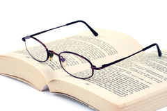 Book and an eyeglasses Stock Photography