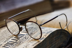 Book and eyeglasses. Old Book and eyeglasses royalty free stock photography