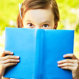 Book and eyes Royalty Free Stock Photography