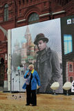Book Fair on Red Square in Moscow. Woman reads poetry of Sergey Esenin Royalty Free Stock Image