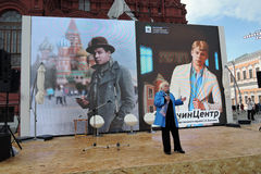 Book Fair on Red Square in Moscow. Woman reads poetry of Sergey Esenin Royalty Free Stock Photography