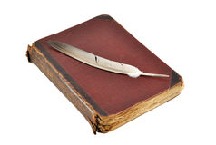 Book with feather Stock Photo