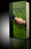 Book financial debt. Book on a table entitled getting out of debt Stock Photo