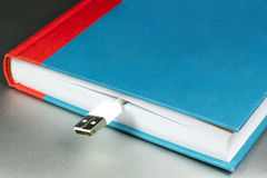 Book and flash drive. Evolution of books in e-book Royalty Free Stock Image