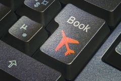 Book flight push button stock photography