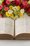 Book and flowers Stock Photography