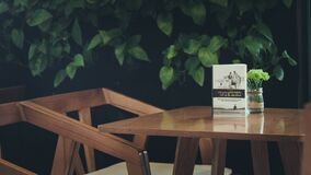 Book and flowers on wooden table royalty free stock photos