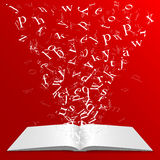 Book with flying letters Stock Images