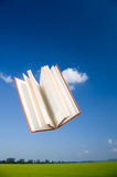 Book flying in the sky Royalty Free Stock Photo