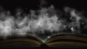 Book in the fog. Mysterious smoke enveloped the book stock video footage