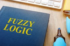 Book about fuzzy logic on a table. Book about fuzzy logic on the table Stock Photo