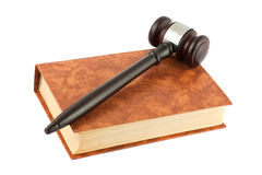 Book and gavel isolated over white Royalty Free Stock Images