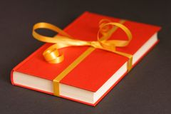 Book gift. Gift wrapped book - very selective focus is on the nearest corner of the book, lots of copy space opportunities Stock Photos