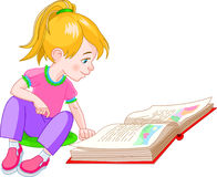 Book girl. Girl  sitting on floor and reading a book Stock Photo