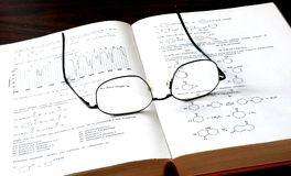 Book and Glass. The chemistry book and eyesglass Royalty Free Stock Photo