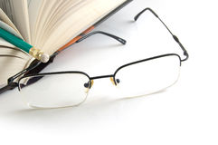 Book and glasses Royalty Free Stock Images