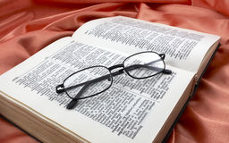 Book and glasses. On silk Royalty Free Stock Photos