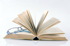 Book with glasses. On white background Royalty Free Stock Images