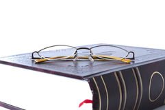 Book and glasses. Glasses lying on book cover. Concept of reading and education Stock Images