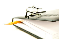 Book and glasses. On the black book glasses lie royalty free stock image