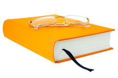 Book with glasses. Photo of the orange book with glasses isolated on white background Stock Photography